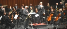 trombonist Martin; trumpeter Larson sharing podium
