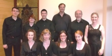 The vocal soloists, with  keyboarder Walker at left & cellist Moersh at each end