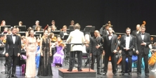 "The soloists performing an aria from ""Barbiere"""