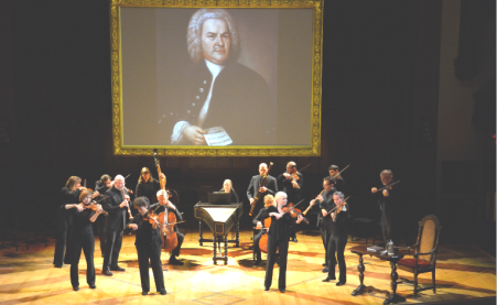 """Tafelmusicians"" under imposing projection of J.S. Bach"
