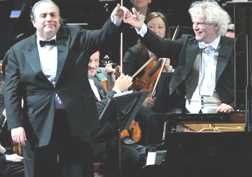 Bronfman with renowned maestro Sir Simon Battle at their 2012 European concert tour