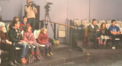 a fascinated audience of youngsters watching a dance duet.