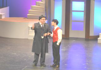FBI cop Buote and Cunha as Frank Jr. in a dramatic on-stage moment